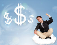 Attractive man sitting on cloud next to cloud dollar signs. Attractive young man sitting on cloud next to cloud dollar signs royalty free stock photos