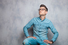 Attractive man sitting while looking up. Royalty Free Stock Photos