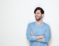Attractive man smiling with arms crossed. Close up portrait of an attractive man smiling with arms crossed Royalty Free Stock Images