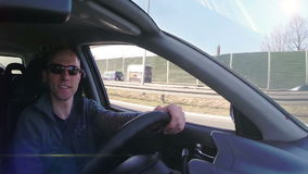 Attractive man smiling during auto trip inside car stock video footage