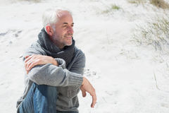 Attractive man smiling on the beach in scarf Stock Images