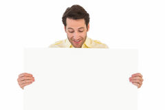 Attractive man smiling and holding poster. On white background Stock Images
