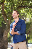 Attractive man smiling outdoors and looking up. Portrait of attractive man smiling outdoors and looking up Stock Images