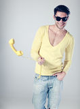 Attractive man smiling and playing with a phone Royalty Free Stock Photography