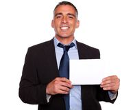 Attractive man smiling and  showing a while card Stock Photography