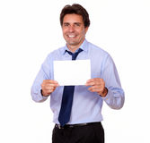Attractive man smiling and showing you a card. Portrait of an attractive man smiling and showing you a card of copyspace on isolated background Royalty Free Stock Images