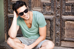 Attractive man smiling wearing sunglasses Royalty Free Stock Image