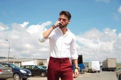 Free Attractive Man Smoking Cigar Walking In Parking Lot Royalty Free Stock Image - 140298466