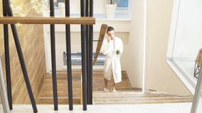 Attractive man spends time in Spa center. Climbs the stairs in a white robe. stock footage