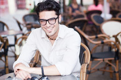 Attractive man standing at a terrace Stock Photo