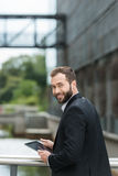 Attractive man standing on an urban bridge stock images