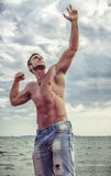 Attractive man staying in the sea Royalty Free Stock Images