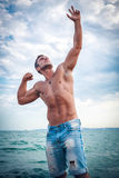 Attractive man staying in the sea Stock Image