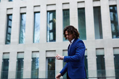 Attractive man in a stylish suit in a hurry for a meeting Stock Image