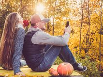 Attractive man and stylish woman holding a mobile phone stock photo