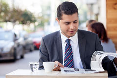 Attractive man with suit is resting in cafe Stock Images