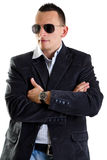 Attractive man with sunglasses posing Royalty Free Stock Photography