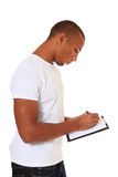 Attractive man taking notes Royalty Free Stock Photography