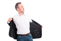 Attractive man taking off his suit jacket Royalty Free Stock Photos