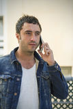 Attractive man talking with mobile phone Stock Images