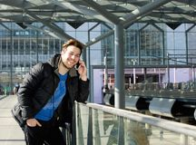 Attractive man talking on mobile phone at station Royalty Free Stock Photography