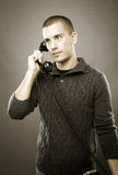 Attractive man talking on phone Royalty Free Stock Image
