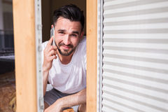 Attractive man talking on the phone Royalty Free Stock Photos