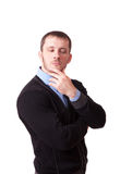 Attractive man thoughtfully rubbing his chin Royalty Free Stock Images