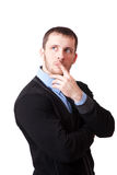 Attractive man thoughtfully rubbing his chin Royalty Free Stock Photos