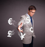 Attractive man throwing currency icons Royalty Free Stock Photography