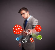 Attractive man throwing dices and chips Stock Photography