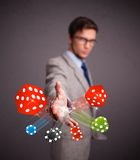 Attractive man throwing dices and chips Stock Photos