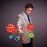 Attractive man throwing dices and chips Stock Images