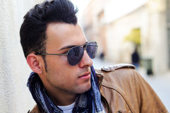 Attractive man with tinted sunglasses. Portrait of a young handsome man, model of fashion, wearing tinted sunglasses Stock Image