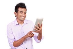 Attractive man with touchpad Royalty Free Stock Photography