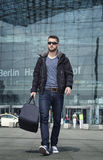 Attractive man with travel bag Stock Photo