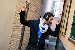 Attractive man in urban background dancing Royalty Free Stock Photo