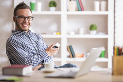 Attractive man using cell phone Stock Photography