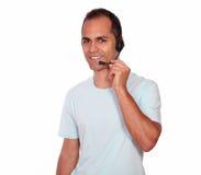 Attractive man using headphones on blue t-shirt Royalty Free Stock Photo