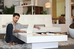 Attractive man using a laptop Stock Photo