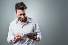Attractive man using tablet Stock Image