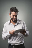 Attractive man using tablet Royalty Free Stock Photos