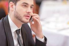 Attractive man visiting luxury restaurant Stock Image