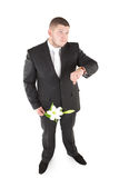Attractive man waiting with flower. Isolated over white Royalty Free Stock Photos