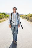 Attractive man walking on rural road Royalty Free Stock Image