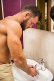Attractive man washing his face Royalty Free Stock Image