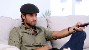 Attractive man watching TV stock video