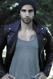 Attractive man wearing a leather jacket and a hat Royalty Free Stock Photography