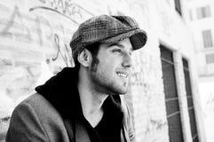 Attractive man wearing a retro cap Stock Photo