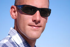 Attractive man wearing sunglasses. Royalty Free Stock Images